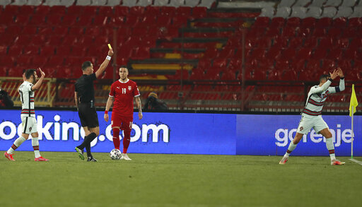 A referee Danny Makkelie gives yellow card to Portugal's Cristiano Ronaldo Serbia Portugal WCup 2022 Soccer Kristijano