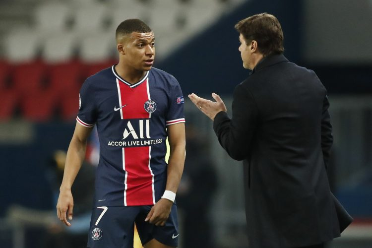 Paris St Germain's Kylian Mbappe with coach Mauricio Pochettino Poketino Embape