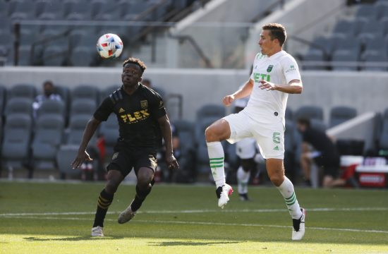 Austin FC defender Matt Besler (5) controls the ball against Los Angeles FC forward Kwadeo Opoku (22) during the second half of an MLS soccer match Saturday, April 17, 2021, in Los Angeles. (AP Photo/Ringo H.W. Chiu)