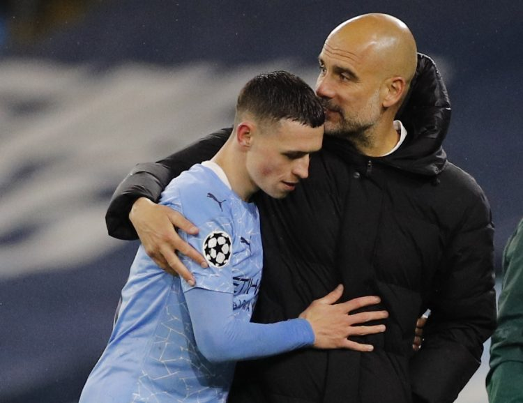 Manchester City manager Pep Guardiola with Phil Foden Gvardiola