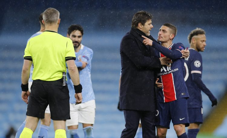 Paris St Germain coach Mauricio Pochettino holds back Marco Verratti as referee Bjorn Kuipers looks on Poketino Kujpers Verati