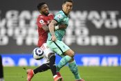 Liverpool's Roberto Firmino in action with Manchester United's Fred