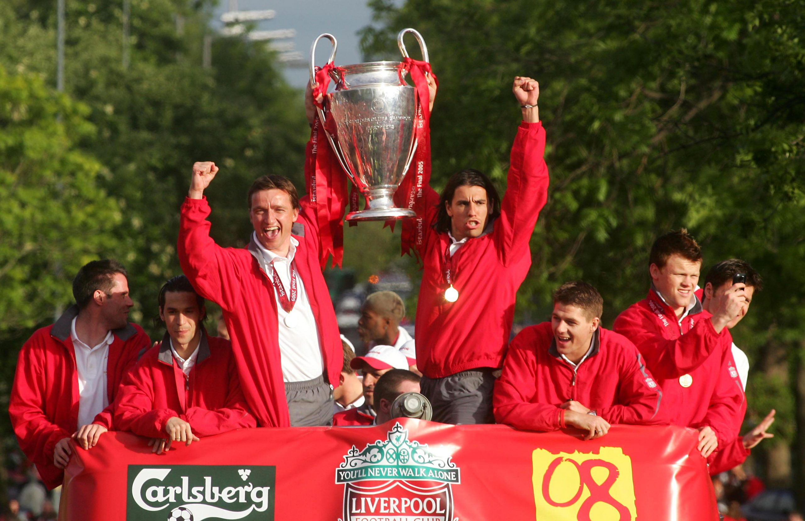 Liverpool's Vladimir Smicer and Milan Baros hold the trophy aloft during a parade through the streets of Liverpool the ...