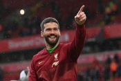 Liverpool's Alisson celebrates after winning the match Becker Alison Beker