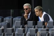 David Beckham, left, owner and president of soccer operations for Inter Miami, watches from the stands with his son Romeo Dejvid Bekam