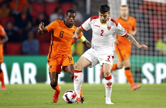Georginio Wijnaldum of Holland, Dusan Lagator of Montenegro during the World Cup qualifying match between the Netherlands and Montenegro at Phillips Stadium on
