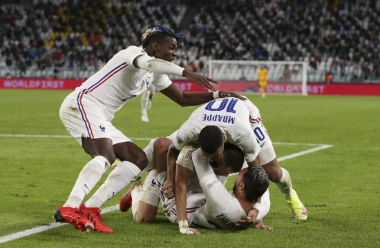 Theo Hernandez of France celebrates with team mates after scoring to give the side a 3-2 lead during the UEFA Nations League match Teo Ernandez
