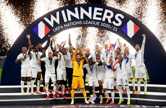 Soccer Football - Nations League - Final - Spain v France - San Siro, Milan, Italy - October 10, 2021 France's Hugo Lloris lifts the trophy as they celebrate after winning the Nations League