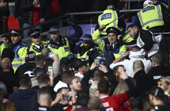 Hungarian fans are restrained by police during the FIFA World Cup qualifiers match at Wembley Stadium, London.