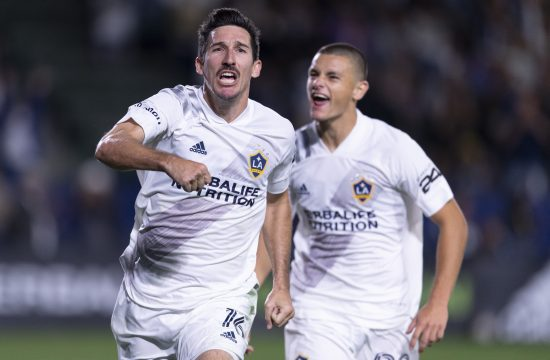 Oct 16, 2021; Carson, California, USA; LA Galaxy midfielder Sacha Kljestan (16) celebrates after scoring the game winning goal off a penalty kick during the second half against the Portland Timbers