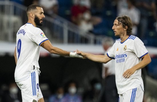 Real Madrid's Karim Benzema, left, celebrates after scoring with his teammate Real Madrid's Luka Modric his side's first goal during the Spanish La Liga soccer match