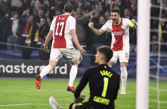 Ajax Amsterdam's Daley Blind celebrates scoring their second goal with Dusan Tadic Ajaks
