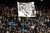 Crystal Palace fans with a banner about Newcastle United's takeover before the match Kristal Palas Njukasl