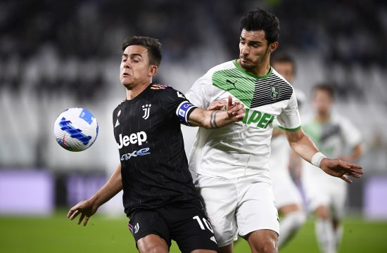 Dibala Sasuolo Serie A Paulo Dybala of Juventus FC is challenged by Kaan Ayhan of US Sassuolo during the Serie A football match between Juventus FC and US Sassuolo.